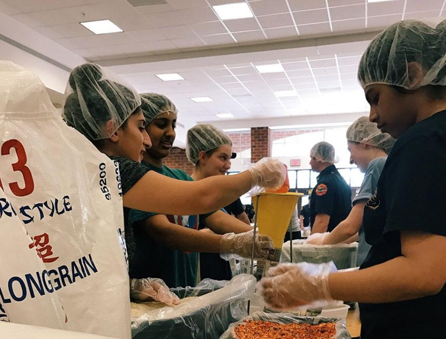 Stop Hunger Now Club Packages Meals for Those in Need