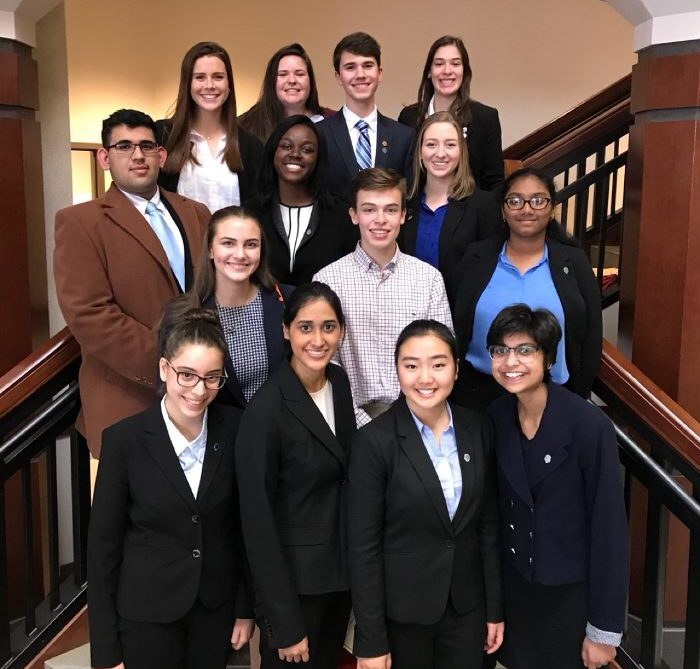 The+2017-2018+Cambridge+Mock+Trial+Team+at+competition.+Top+row%2C+from+left+to+right%3A+Amelia+Green%2C+Madison+Whitson%2C+Colin+Baron%2C+Morgan+Maiorino.+Second+row%2C+from+left+to+right%3A+Ayush+Kumar%2C+Bona+Bitegeko%2C+Allie+Kench.+Third+row%2C+from+left+to+right%3A+Cheney+Dunwoodie%2C+Andrew+Maiorino%2C+Sisira+Amara.+Fourth+row%2C+from+left+to+right%3A+Shir+Halfon%2C+Srijita+Nandy%2C+Cherise+Kim%2C+Ruhi+Shirke.