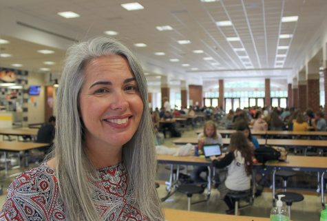 Principal Kimberly Premoli on lunch duty in the cafeteria, where she interacts with students daily.
