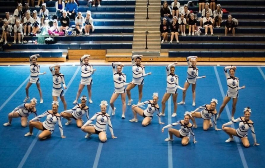 Varsity+Cheer+performing+their+routine+at+Johns+Creek+High+School.++