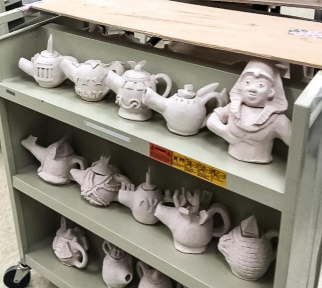 A cart of pinch pot teapots made by Harris's Ceramics 1 class.