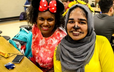 "Junior Kimberly Poinsette as Minnie Mouse and Junior Duaa Tariq as a ""Coco"" Skeleton"
