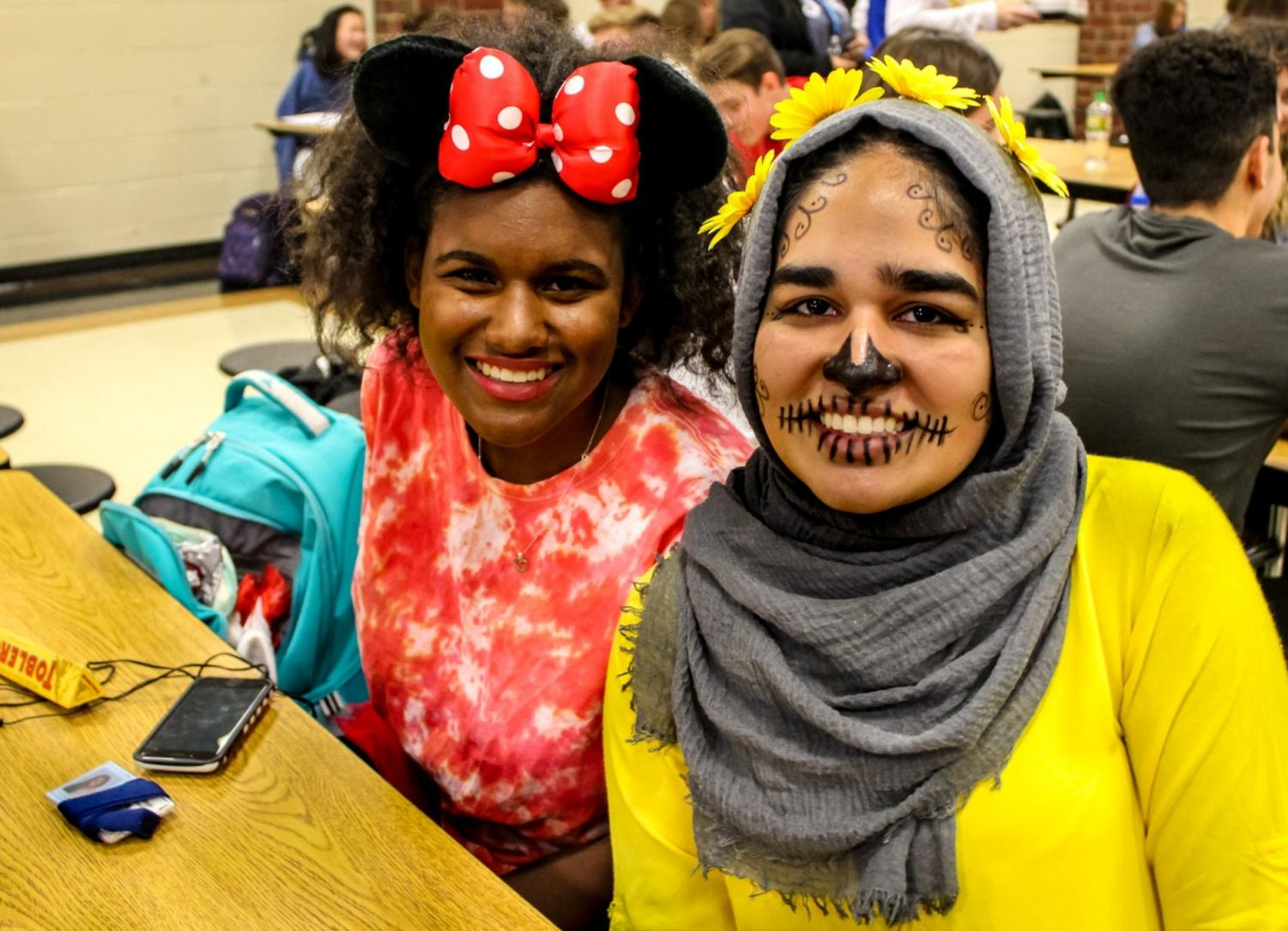Cambridge students did not disappoint in showing their Halloween pride.  Picture here are junior Kimberly Poinsette as Minnie Mouse and junior Duaa Tariq as a