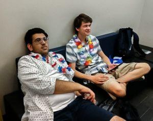 Senior debaters Ayush Kumar (left) and Logan Sowder (right) in their debate attire: leis and Hawaiian shirts