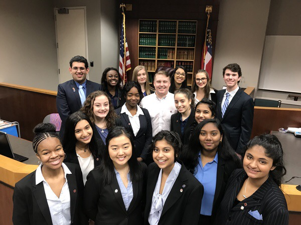 Members of the mock trial team, along with attorney coach Chris Howard.
