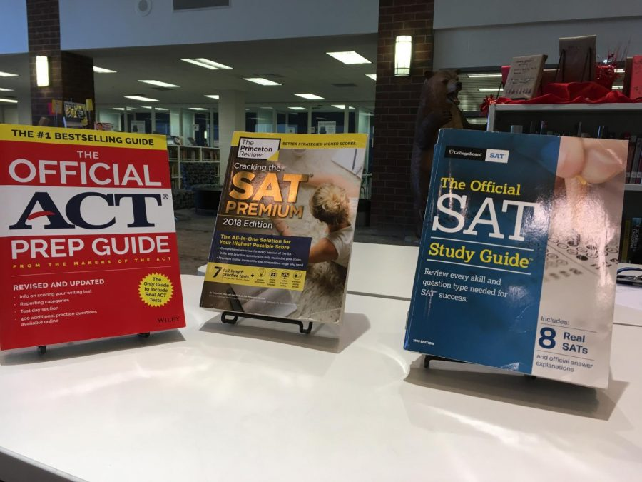Several+prep+books+for+the+SAT+and+ACT.++Study+books+like+these+offer+less+expensive+alternatives+to+tutoring.