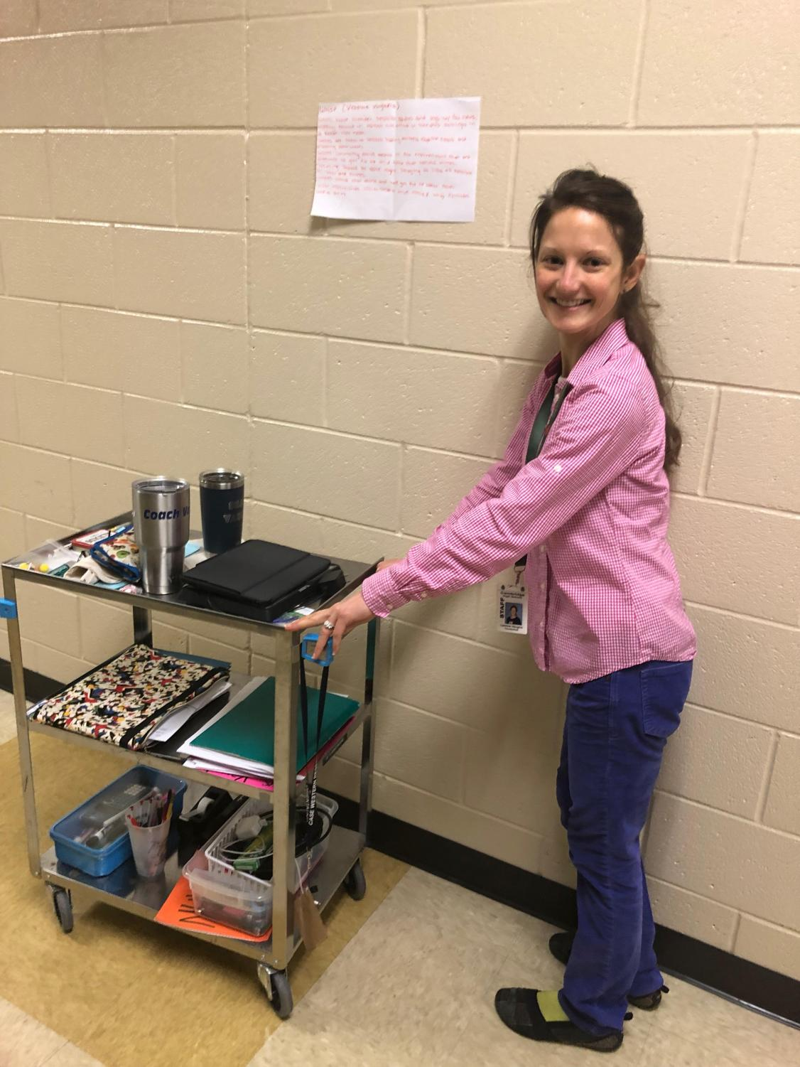 Chemistry teacher Leanne Vaughn with her cart, which carries many of her classroom materials.