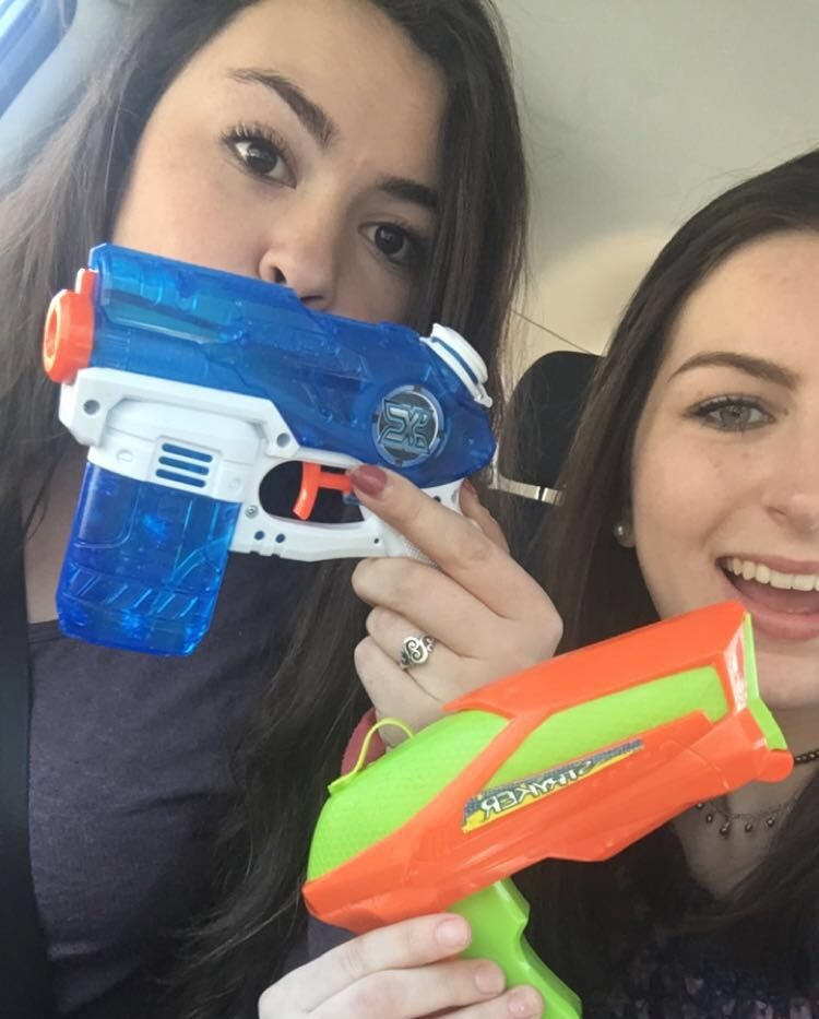 Birkholz and her partner posing with their water guns.