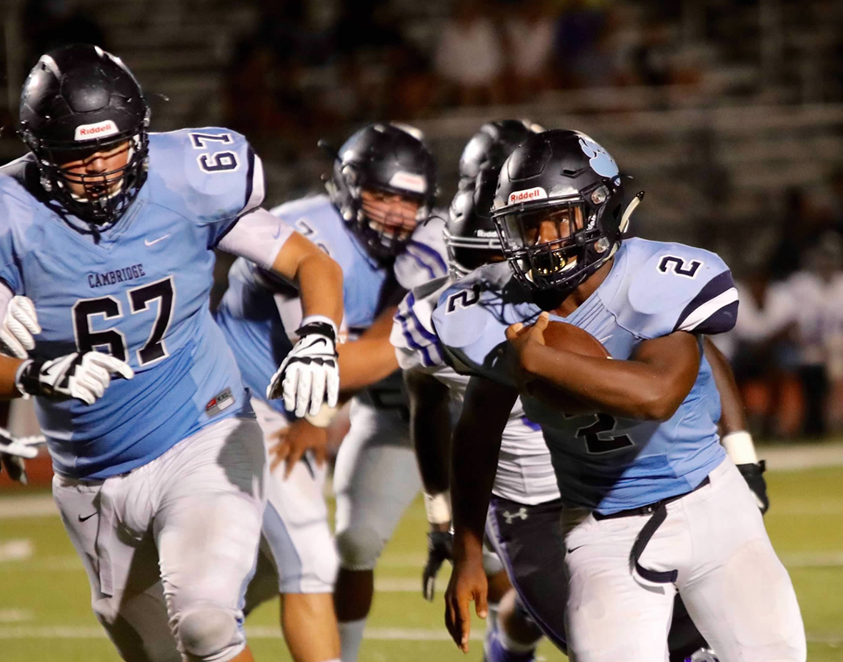 Junior Phillip Michael Collins running the ball in a game against Centennial High School.