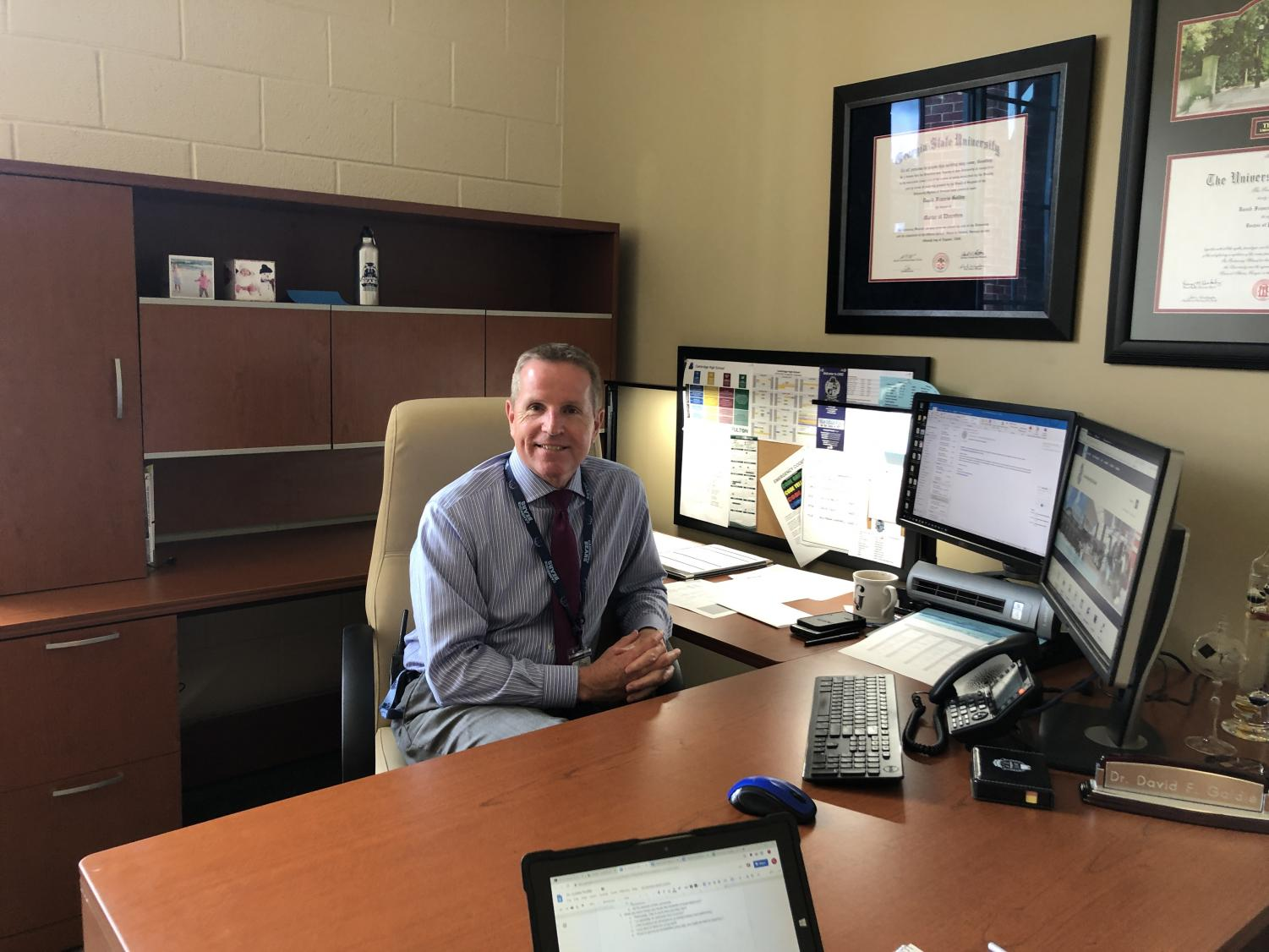 New assistant principal David Goldie in his  office, surrounded by his accolades and Cambridge memorabilia.