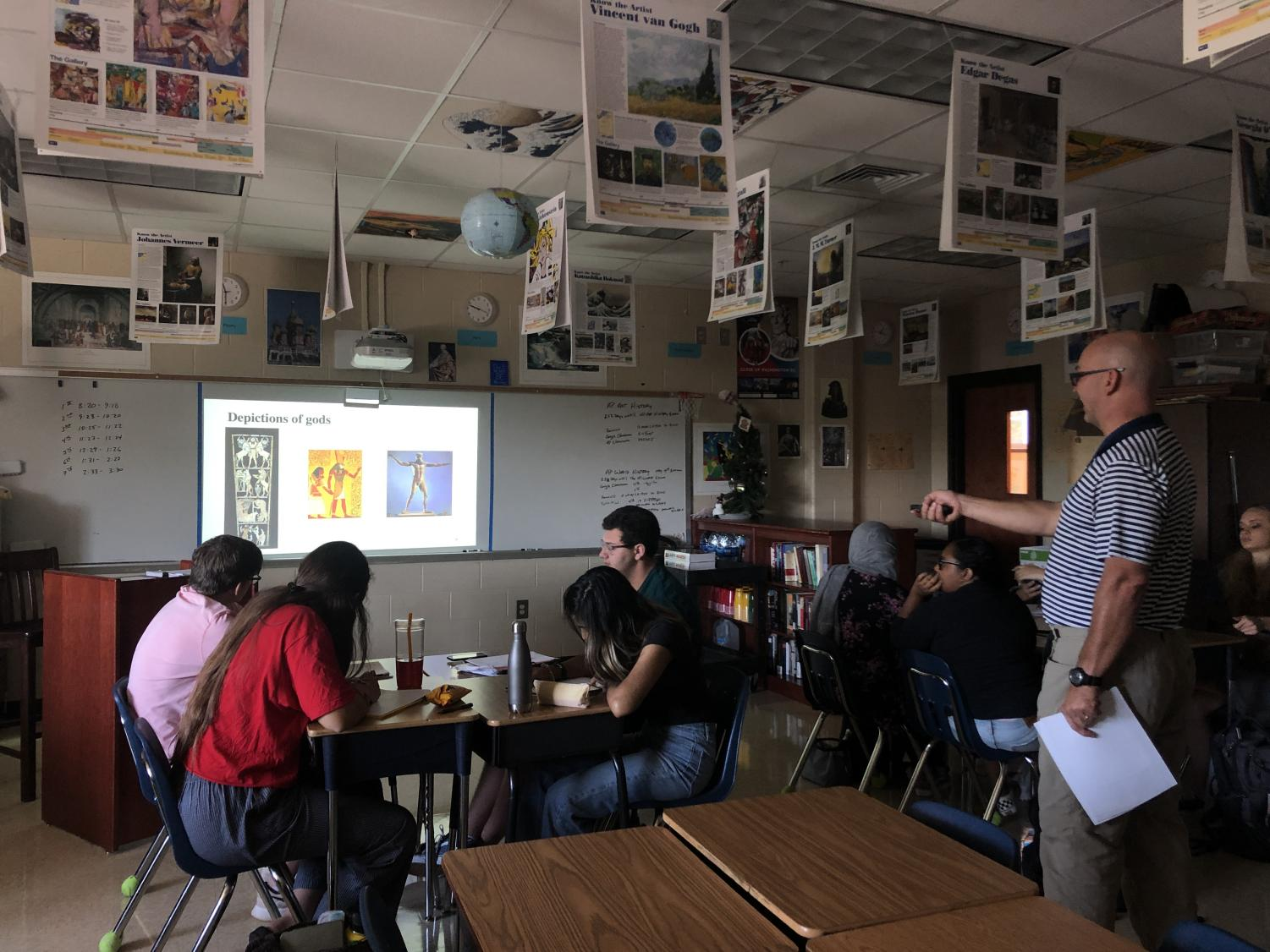 AP Art History teacher Mark Schuler giving a lesson about ancient Egyptian artwork.