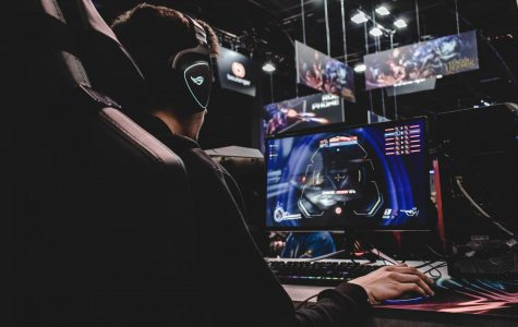 What a typical esports match may look like, complete with a headset and computer set.