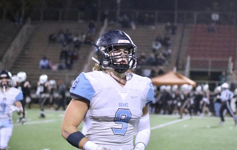 Senior linebacker, Luke Ritter, walking across the field.