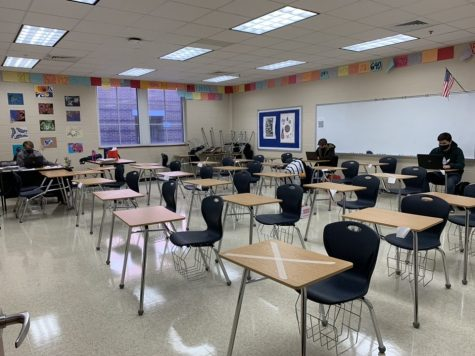 Pomerance teaches to an almost-empty classroom.