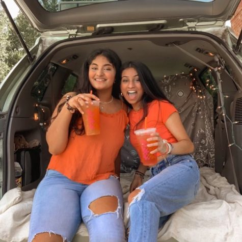 Sharma and Suram sit in their trunk where they usually record their podcast, Slam Trunk.