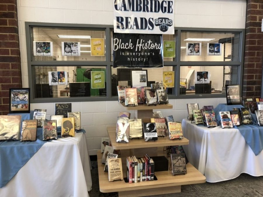 Morgan+set+up+a+display+of+books+written+by+African+American+authors+at+the+entrance+to+the+media+center.