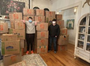 Moeller (left) and Parry (right) standing next to their shoe donation collection.