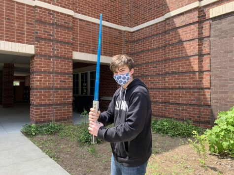 Pippins poses with one of his lightsabers in Luke Skywalker