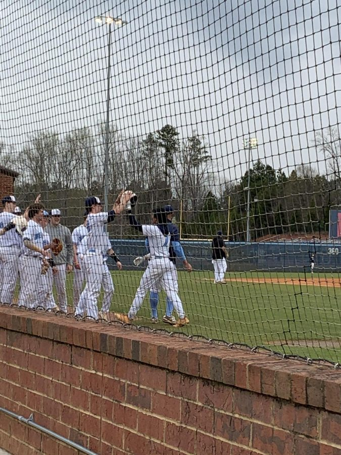 After Senior Jayden Carbonell-Smith hit a home run, the team ran out of the dugout to congratulate him.
