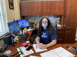 Mrs. Agans sitting at her desk in her office.
